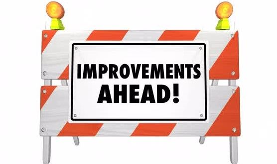 improvements-ahead-road-construction-sign-barrier